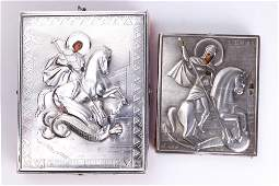 An assembled pair of Russian 84 silver oklad icons of