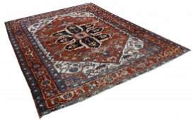 An antique Persian Heriz carpet