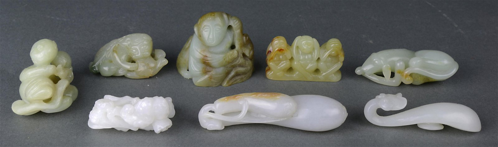 (lot of 8) A group of eight carved Jade figures