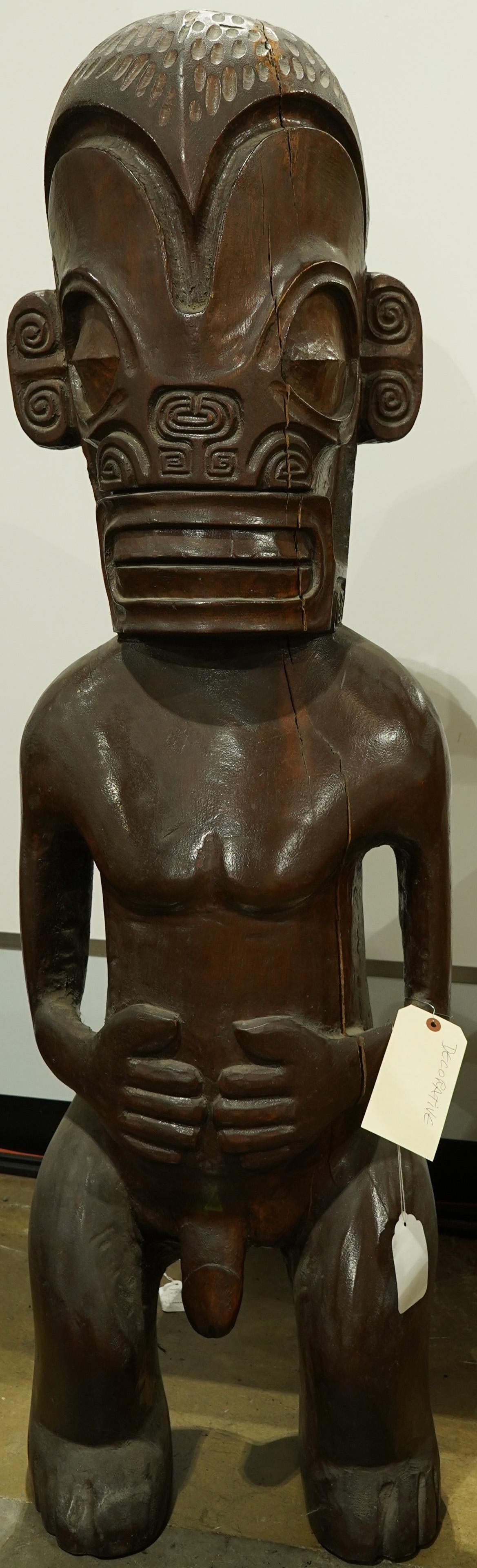 A decorative polynesian wood sculpture of a tiki