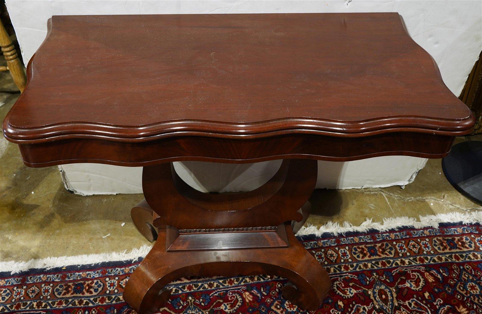 An Empire style mahogany flip top table