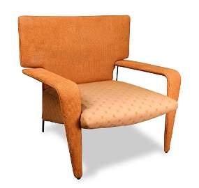 A Mid-Century Modern style orange upholstered lounge