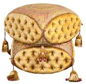 A custom made tufted and tassel decorated stool in the