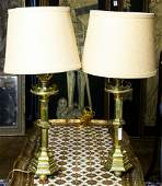 A pair of continental brass candlestick form table