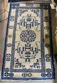 Chinese Baotou ivory ground rug