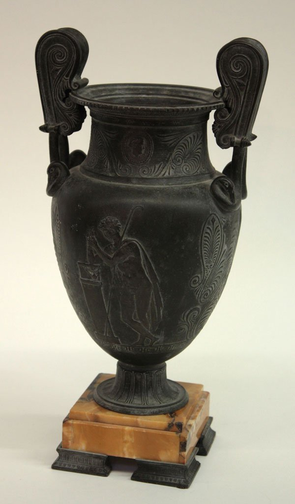 2022: Metal urn with Romanesque relief