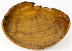 A Rude Osolnik (1915-2001) wood turned live edge bowl