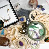 A collection of multistone gold and metal jewelry