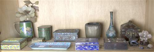 A shelf with Chinese stone, cloisonne and other metal