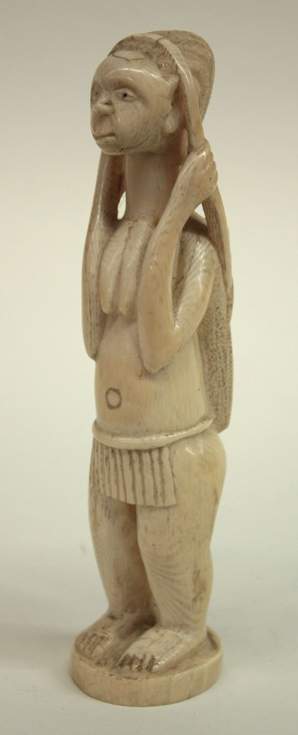17: African ivory carving, early Tourist