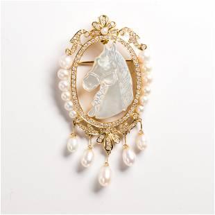 A pearl, diamond and fourteen karat gold brooch