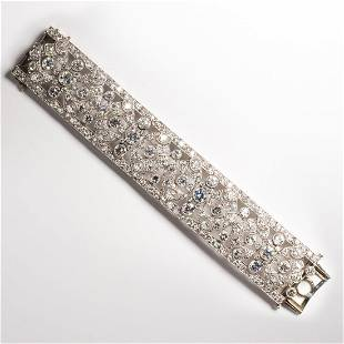 A French Art Deco diamond and platinum strap bracelet