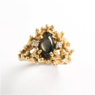 A synthetic black star sapphire, diamond and eighteen