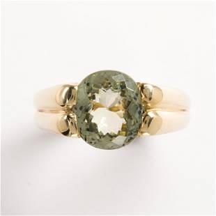A tourmaline and fourteen karat gold ring