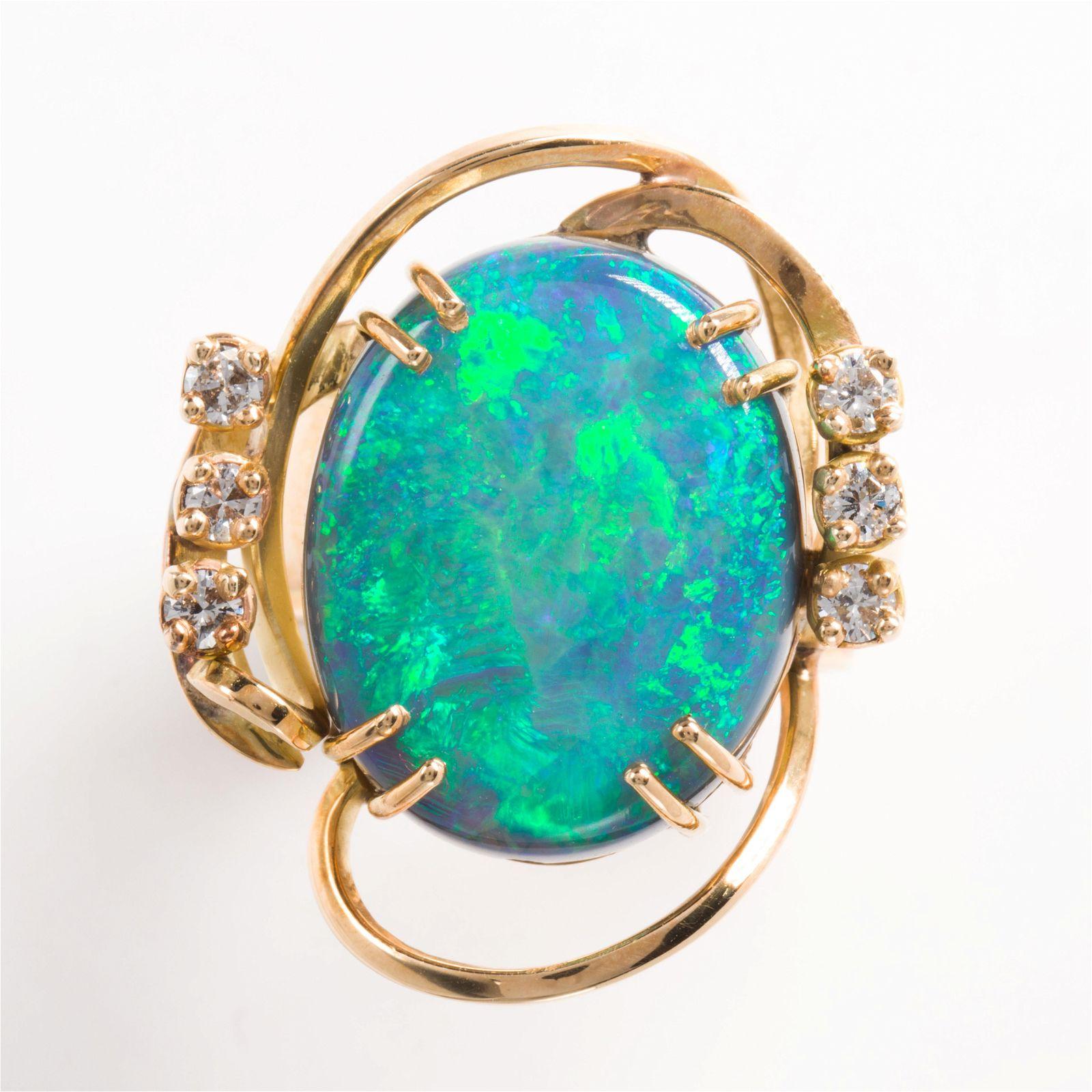 A black opal, diamond and fourteen karat gold ring