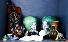 One shelf of Asian style wood and ceramic decoratives