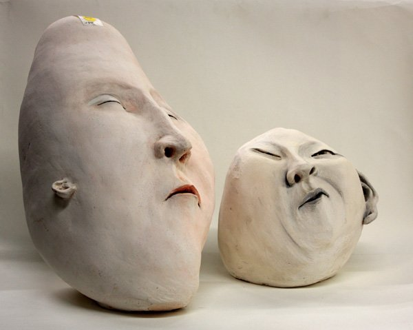 4516: Grotesque sculpture heads by Charlene Doiron Rein