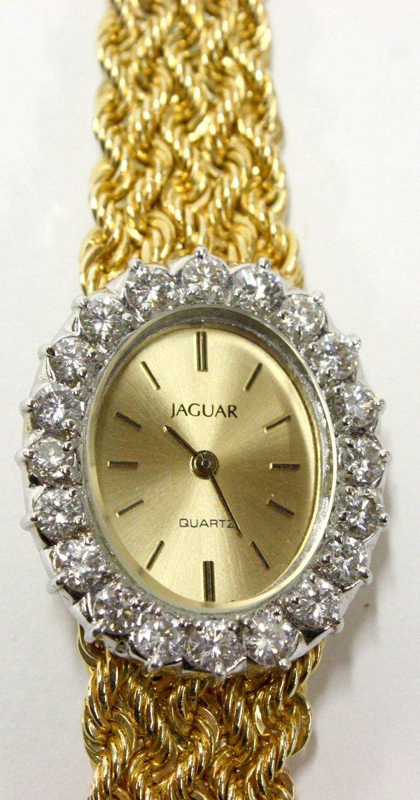 4523: 14k yellow gold and diamond women's Jaguar watch