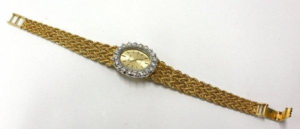 4523: 14k yellow gold and diamond women's Jaguar watch - 2