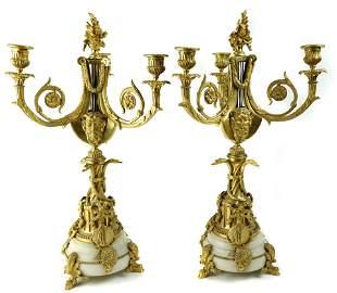 A pair of Rococo style gilt bronze candelabras