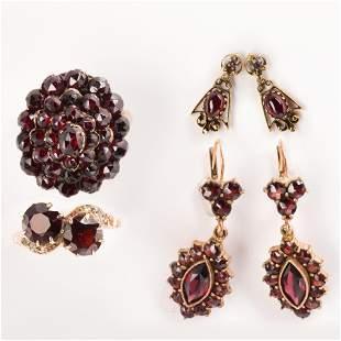 A group of garnet and fourteen karat gold jewelry,