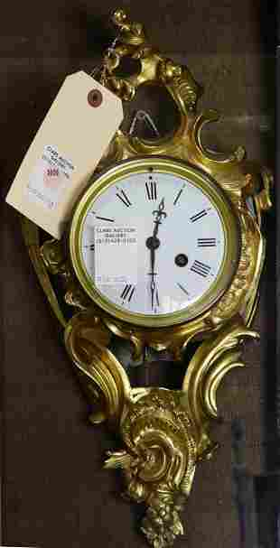 A French gilt bronze wall clock circa 1890 in the