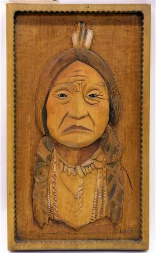Native American carved wood portrait