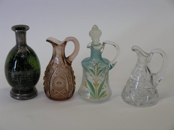4010: Cruets and silver overlay bottle