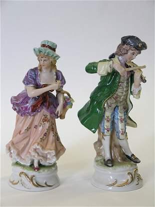 Porcelain figurals of a maiden and a fiddler