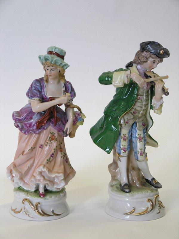 4013: Porcelain figurals of a maiden and a fiddler