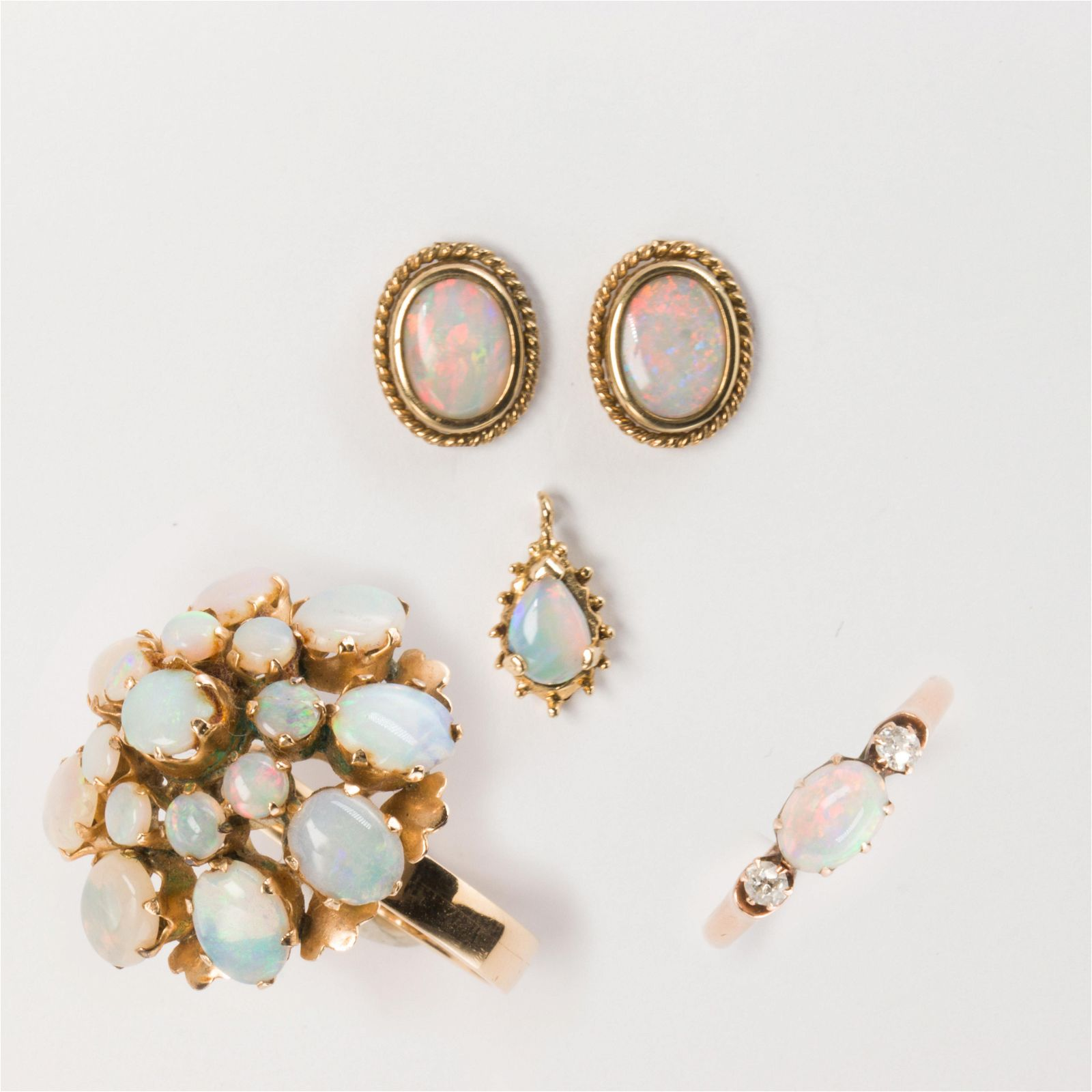 A group of opal and gold jewelry
