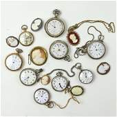 A collection of pocket watches and cameos