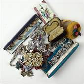 A group of costume jewelry and wrist watches, including