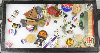 A rikers tray of button and medals