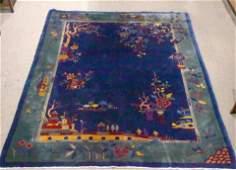 A Chinese Art Deco carpet, the cobalt blue ground