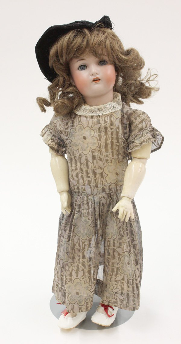 22: Wolfe and Company bisque socket head doll