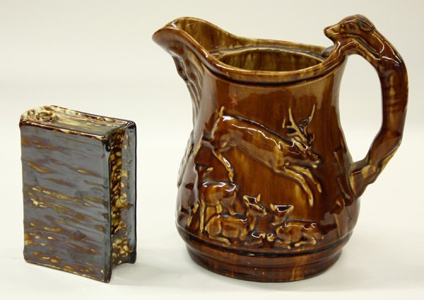 24: Rockingham pottery book form whiskey flask