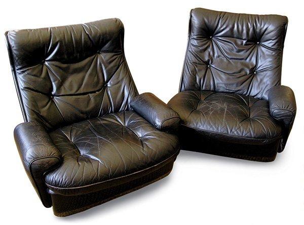 201: Airborne International black leather lounge chairs