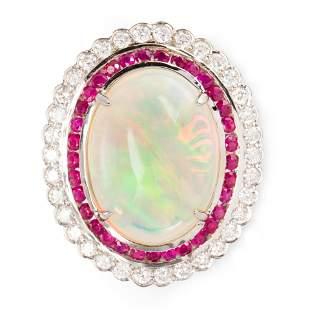 An opal, ruby, diamond and fourteen karat gold ring