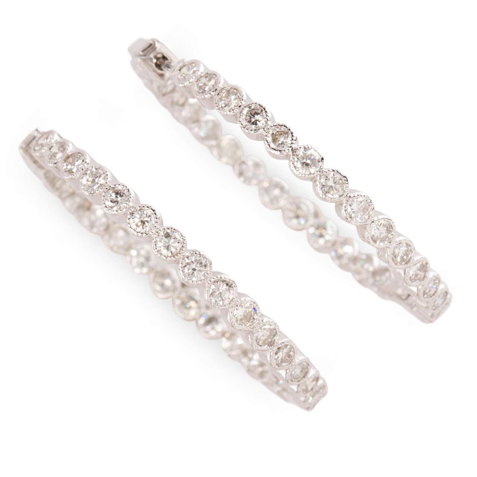 A pair of diamond and eighteen karat white gold hoop