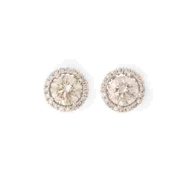 A pair of diamond and eighteen karat white gold stud