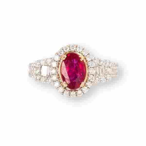 A ruby, diamond and fourteen karat white gold ring