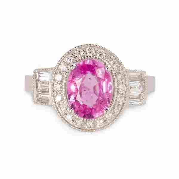 A pink sapphire, diamond and platinum ring