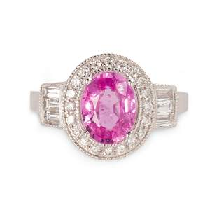 A pink sapphire, diamond and platinum ring