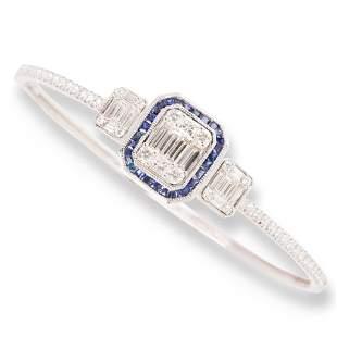 A sapphire, diamond and eighteen karat white gold