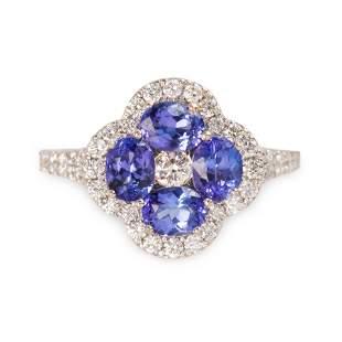 A tanzanite, diamond and fourteen karat white gold ring