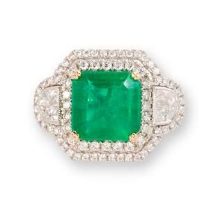 An emerald, diamond and eighteen karat white gold ring