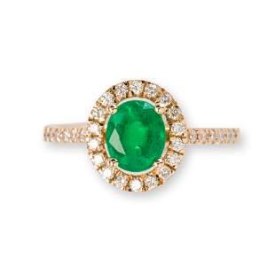 An emerald, diamond and fourteen karat gold ring