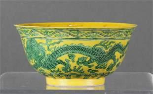 Chinese green glazed yellow ground dragon bowl