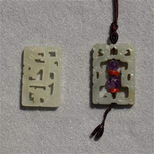 Pair of Chinese dragon and phoenix pendants